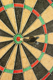 Right in the target. Concept of having business success by throwing darts Stock Image