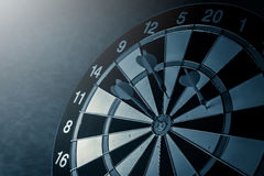 Right on target concept using dart in the bullseye on dartboard Royalty Free Stock Photography