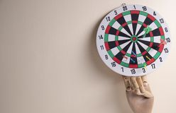 Dart board hang on the wall. Right on target concept using dart in the bullseye on dartboard business success concept stock photos