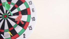 Red dart and green dart on the dart board on the wall. Right on target concept using dart in the bullseye on dartboard business success concept stock image
