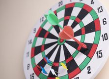 Two dart on the dart board on the wall. Right on target concept using dart in the bullseye on dartboard business success concept stock images