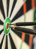 Right on target. Couple of darts  focused on bulls eye Stock Photos