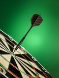 Right on target. Dart focused on bulls eye  . A good metaphor for perfection and accuracy Stock Photo