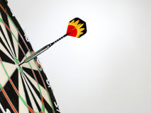 Right on target. Dart focused on bulls eye  . A good metaphor for perfection and accuracy Royalty Free Stock Image