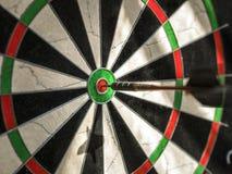 Right on target. In flight dart  focused on bulls eye Royalty Free Stock Photos