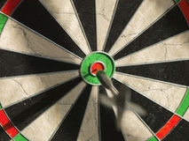 Right on target. In flight dart  focused on bulls eye Royalty Free Stock Photo