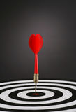 Right on target (portrait). Portrait shot of a Red dart on bull's eye of a dart board Royalty Free Stock Photos