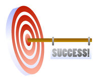 Right on target of success. Arrow in the middle of a target representing success in life or business Royalty Free Stock Photography