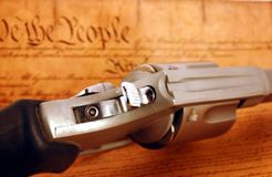 Right to Bear arms. A handgun positioned on top of  a copy of the constitution Royalty Free Stock Image