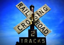 On the right track. A Close up shot of a ageing weathered railway crossing sign Stock Photo