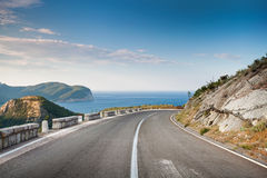 Right turn of mountain highway Royalty Free Stock Image