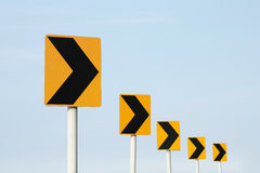Right turn sign. Four right turn sign over sky Stock Photo