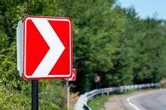 Right Turn Sign. Road signs warn of a sharp turn.  royalty free stock photo