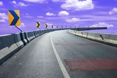 Right turn sign to the end of the empty highways road and blue sky background stock images