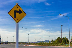 Right Turn Sign. A sign warns of a sharp right turn on a road Royalty Free Stock Image