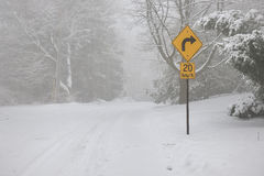 Right turn warning sign on winter road Royalty Free Stock Image