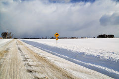Right Turn - Western New York Winter. A lone traffic sign points the way from the edge of an empty, snow bound Western New York farm fields royalty free stock image