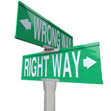 Right vs Wrong Way - Two-Way Street Sign. A green two-way street sign pointing to Right Way and Wrong Way Royalty Free Stock Images
