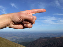 The Right Way. Pointing hand against the blue sky background Stock Images