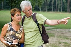 Is this the right way? -2. Active senior couple on a hike royalty free stock photography
