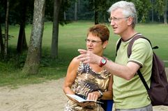 Is this the right way? -3. Active senior couple on a hike royalty free stock images