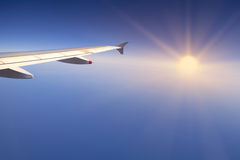 Right wing of an aircraft the sun. Right wing of an aircraft flying over Mediterranean Sea and the sun Royalty Free Stock Images