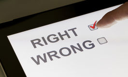 Right and wrong checkboxes on a tablet. Clicking right Stock Image