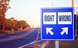 Right or Wrong choices, decision, option. Road sign on a highway with two different choices and arrows indicating the destination or decision Royalty Free Stock Image
