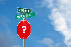 Right or wrong  concept. With signpost against blue sky background Royalty Free Stock Photography