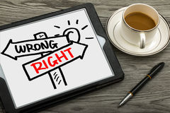 Right or wrong signpost hand drawing on tablet pc. Right or wrong signpost concept hand drawing on tablet pc Stock Photos