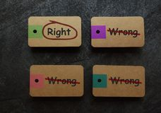 Right and Wrong tags. Right and wroing paper tags with Right text circled Stock Photo