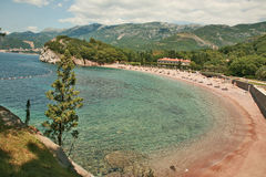 The rightside beach of Sveti Stefan. King's Beach, officially named Miločer Beach, is surrounded by 18 acres of park containing exotic flora such as Lebanese Stock Images