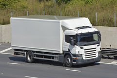 Rigid body lorry on motorway Stock Photo