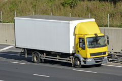 Rigid body unmarked lorry on motorway Stock Photos