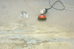 Rigid cleaning of concrete floors with an electric grinder Stock Images