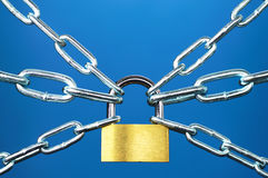 Rigid control. Padlock and chain on blue background Royalty Free Stock Image