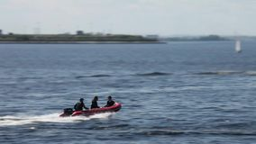 Rigid Inflatable Boat high speed. Tracking shot stock video footage