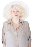 Rigid Lady in Brown. Single stoic European female with safari cap and shirt Royalty Free Stock Photos