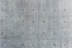 Rigido solido grigio di struttura del muro di cemento immagine stock