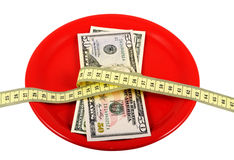 Rigorous Diet_4. Ceramic plate with money and measuring tape. Symbolize a diet and the control over meal Royalty Free Stock Images