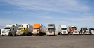 Rigs in a row. A group of large trucks in a row Royalty Free Stock Images