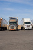 Rigs in a row. A group of large trucks in a row Stock Photography