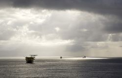 Rigs in the South China Sea. Silhouette of offshore rigs, South China Sea, Brunei royalty free stock images