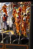 Rigworkers et navire de transport Photo stock