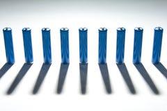 Rij van blauwe batterijen Stock Foto's