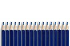 Rij van blauwe potloden Stock Foto's