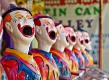Rij van clowns bij feest of markt stock foto