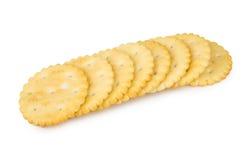 Rij van crackers op wit Stock Foto's