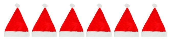Rij van de hoeden van de Kerstmiskerstman Royalty-vrije Stock Afbeeldingen
