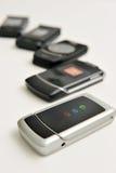 Rij van gebruikte cellphone Stock Afbeeldingen